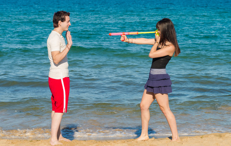 holdup: Atacking him with a  dangerous summertime weapon Stock Photo