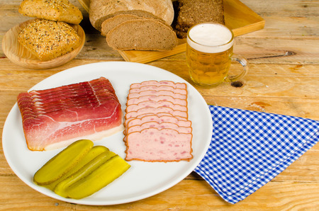Cold meat, pickles, whole wheat bread and beer, a traditional German cold meal