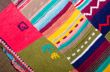 Full frame take of knitted woolen patchwork