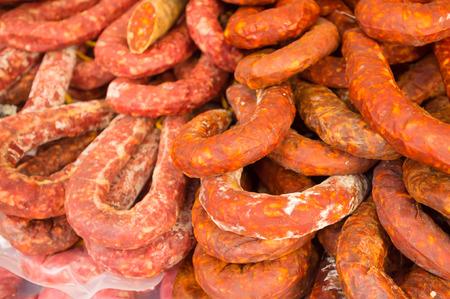 chorizos: Full frame take of a heap of traditional chorizos at  a market stall Stock Photo