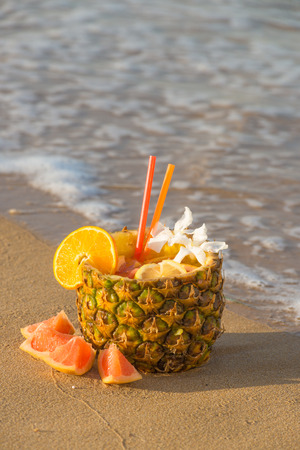 emptied: An emptied pineapple used to serve a refreshing cocktail