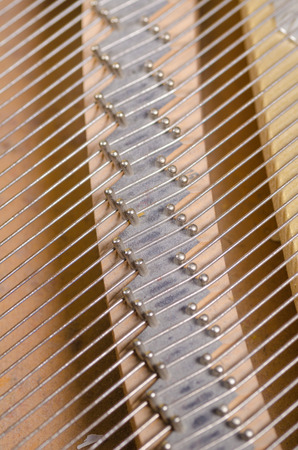 classical mechanics: Full frame take of pins and strings inside a piano Stock Photo