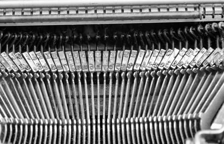 typebar: Closeup take of an old typewriter mechanism with its set of keys and letters