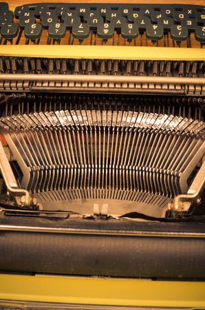 typebar: Detail take of and old typewriter and its mechanism