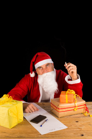 Tired and frustrated Santa smoking a cigarette Stock Photo - 30358729