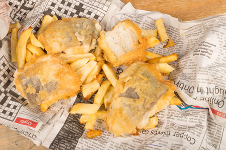 Fish and chips on their traditional newspaper wrap photo