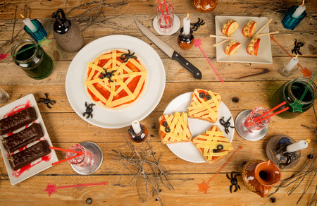 party with food: Assorted creative Halloween party food on a wooden table