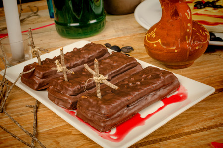 Small chocolate cakes resembling a coffin,  spooky Halloween party dessert photo