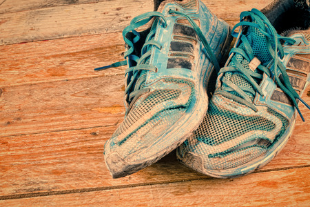 worn out: Very dirty and worn out sports shoes Stock Photo