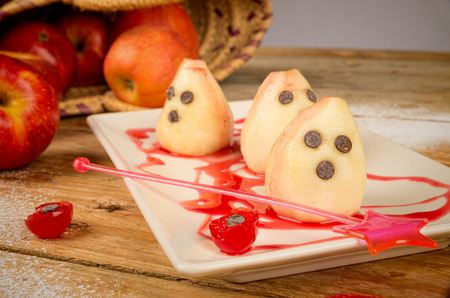 Spooky pears, a Halloween dessert for children photo