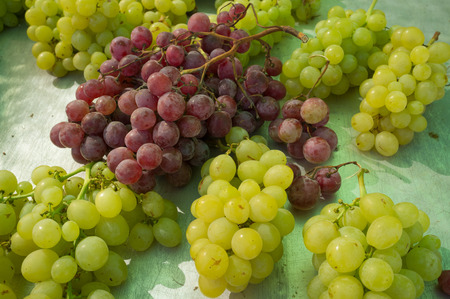 market stall: Bunches of grapes on display at a street market stall Stock Photo