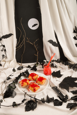 Spooky Halloween muffins with a deep red sauce photo