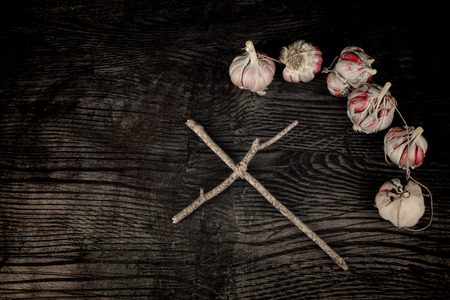 exorcism: Exorcism still life,a a wooden cross and garlic bulbs Stock Photo