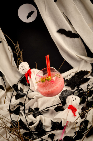 A glass with a spooky Halloween party cocktail photo