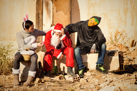 Depressed Santa Claus being cheered up by his holiday buddies Banco de Imagens