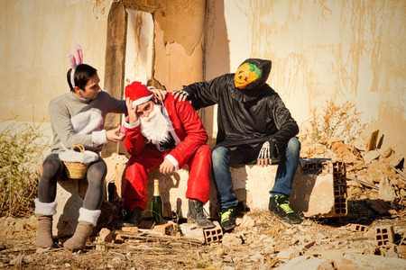buddies: Depressed Santa Claus being cheered up by his holiday buddies Stock Photo