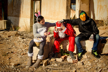Depressed Santa Claus being cheered up by his holiday buddies Imagens