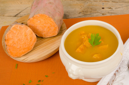 Homemade sweet potato soup with its main ingredient next to it Reklamní fotografie - 32457184