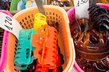 street market: Assortment of hair slides on a street market stall Stock Photo