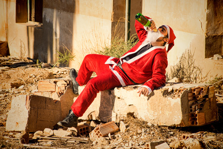 indulging: A stressed out Santa indulging in a bottle of champagne