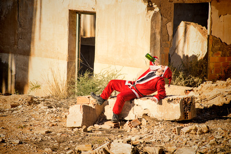 burnt out: A stressed out Santa indulging in a bottle of champagne