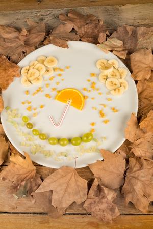 Fruit salad decorated as an autumn setting, creative kid food photo