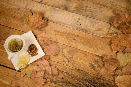 Cup of lemon tea in an autumn setting photo