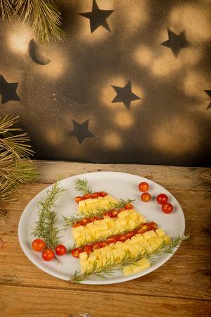 A fruit salad set up as a Christmas tree, creative kid food photo