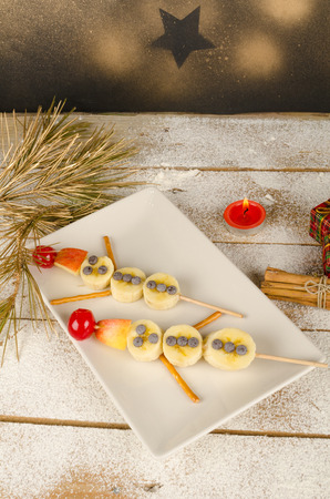 Fruity Christmas dessert set up and decorated as a kid meal photo
