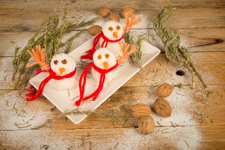 Funny rice snowmen, a kid meal for Christmas photo