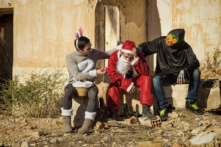 burnt out: Overworked Santa being  cheered up by his holiday buddies