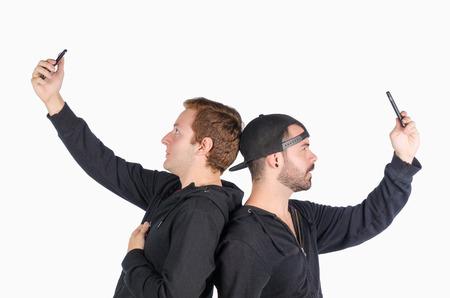 narcissistic: Two guys in their twenties having fun with selfies