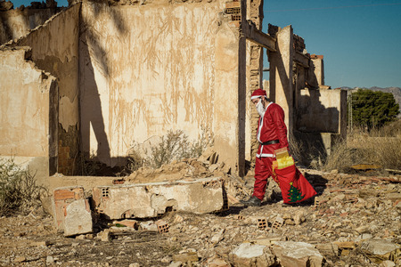 fed up: A fed up  Santa trudging along with his sack