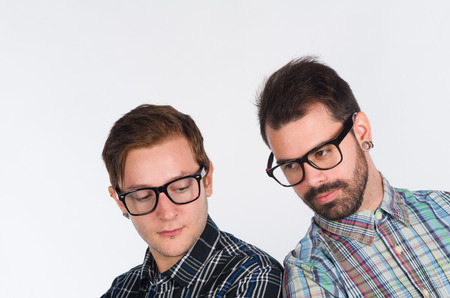 twenties: Studio shot of tho nerd looking males in their twenties Stock Photo