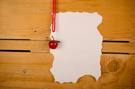 Parchment for a Christmas wish list against a rustic wooden background photo