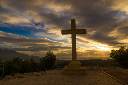 dramatic: A huge stone cross against a dramatic sky Stock Photo