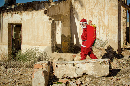 burnt out: A fed up  Santa trudging along with his sack