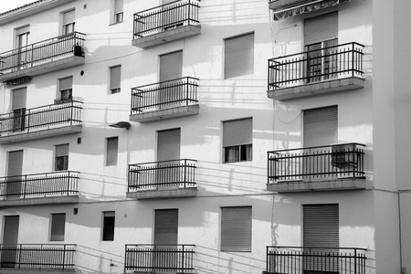 impersonal: Full frame black and white take of a shabby apartment block Stock Photo