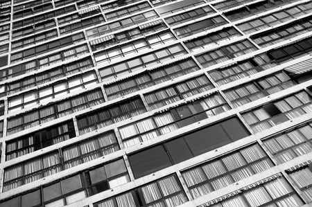 impersonal: Full frame take of an impersonal skyscraper facade in black and white