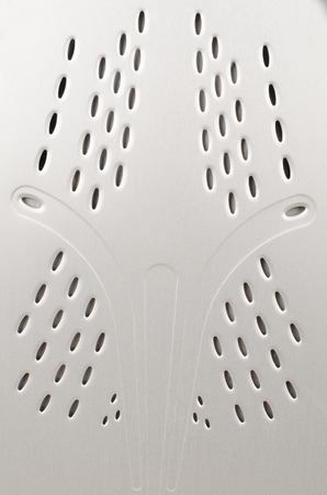 full of holes: Full frame take of  the holes on the bottom of a domestic iron
