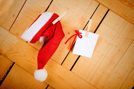 wish list: Wish list and Santa  cap hanging on a rustic wooden door