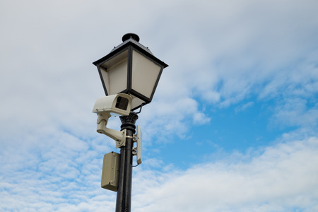 closed circuit television: CCTV  camera mounted on a  classic street lamp