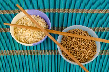 coriander seeds: Dried lemon grass and coriander seeds, aromatic condiments Stock Photo