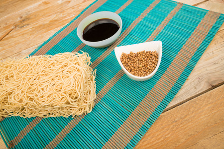 buch: A buch of  Chow Mein noodles and bowls with condiments