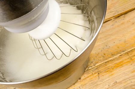 food processor: Egg whites being whisked inside a modern food processor