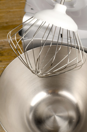 food processor: Whisk tool above the bowl of a food processor Stock Photo