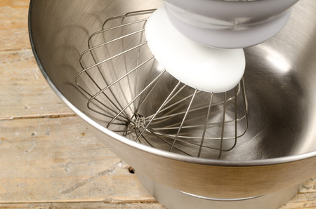 food processor: Whisker tool of a food processor inside its bowl