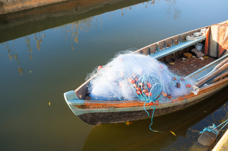 prow: Old boat with fishing nets on its prow Stock Photo