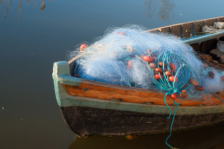 fishing nets: Old boat with fishing nets on its prow Stock Photo