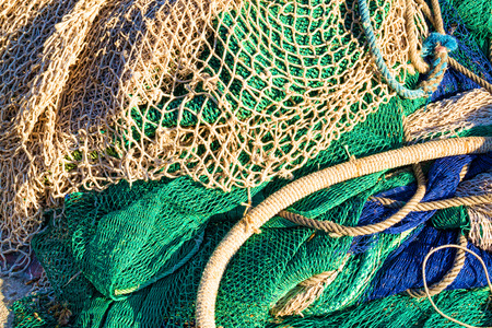 fishing nets: Fishing nets and other tackle in a messy pile Stock Photo
